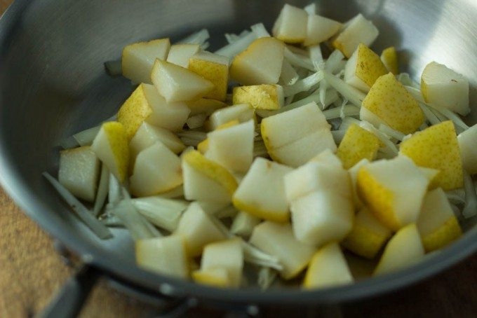 pear and onion in pan