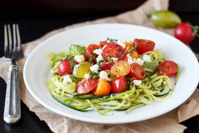 zucchini pasta with tomatoes and feta featured