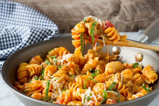 spicy sausage and spinach skillet pasta_