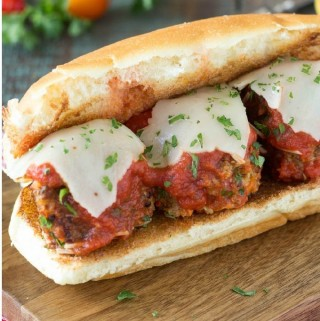 "Quinoa Meatball Sandwich - ""Meatballs "" smothered in rich marinara and topped with melty Provolone cheese and served on a toasty bun. Sounds like something you would have to shy away from if you were trying to eat healthy, watch your calories or follow a vegetarian diet? Oh no no you don't!"