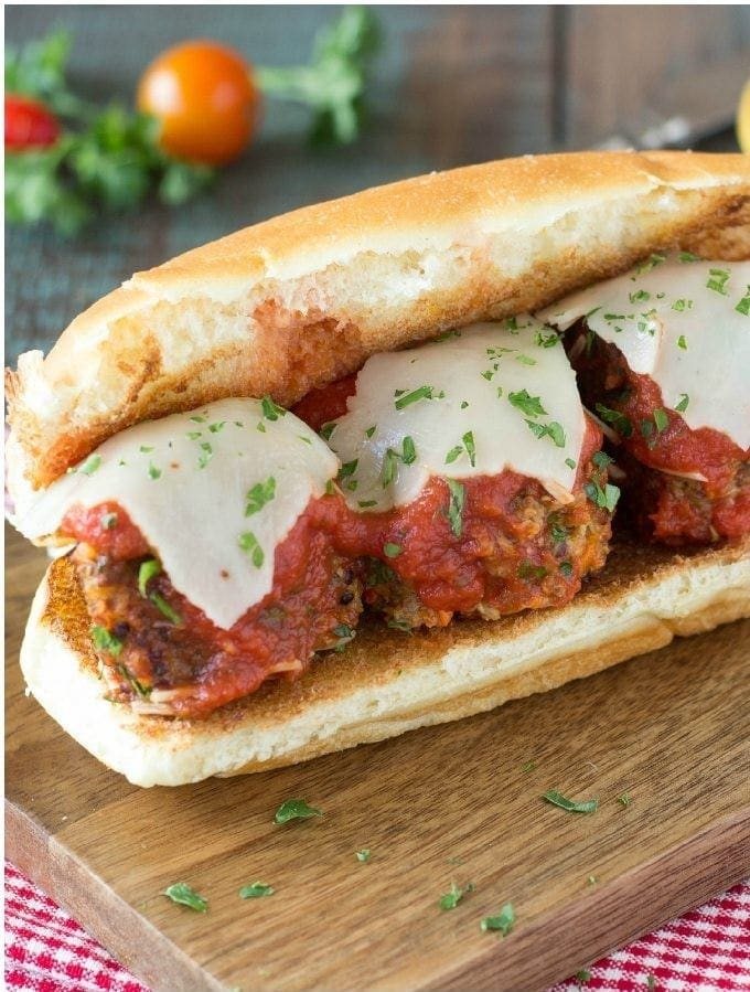 """Quinoa Meatball Sandwich - """"Meatballs """" smothered in rich marinara and topped with melty Provolone cheese and served on a toasty bun. Sounds like something you would have to shy away from if you were trying to eat healthy, watch your calories or follow a vegetarian diet? Oh no no you don't!"""