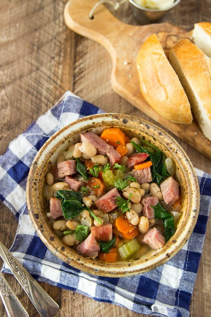 Ridiculously easy! This One Pot Ham and White Bean soup is hearty and chalk full of favorites like chunks of ham, white beans, carrots, celery and a bit of spinach for some extra veggie power.