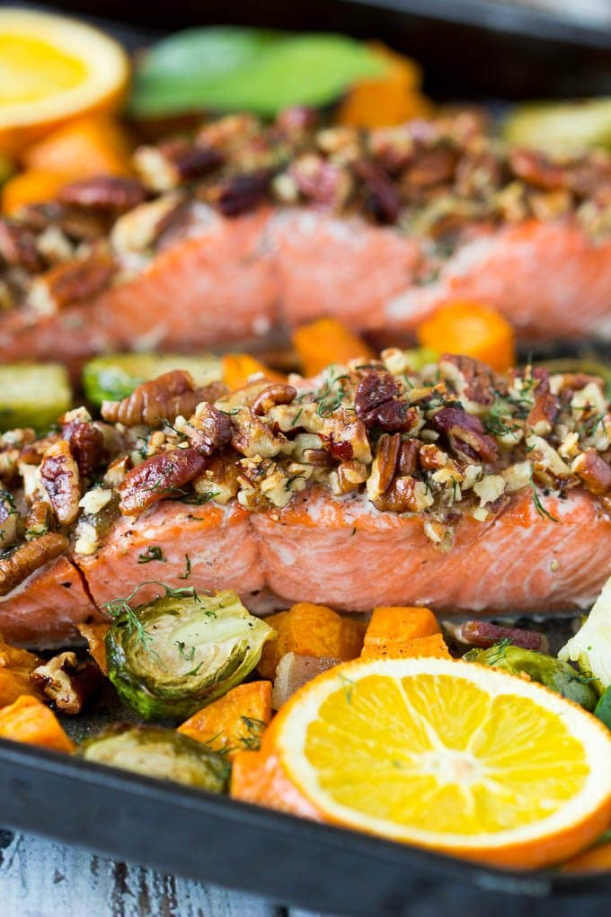 Crazy easy!. This pecan crusted oven baked salmon dinner takes just a few minutes of prep time. Salmon,veggies and sweet potato cook together on one sheet-pan. About 20 min. later out pops a healthy and delicious complete meal.