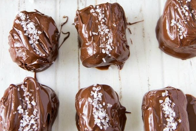 "Sea Salt ""Caramels""- Only 3 ingredients needed to make these healthy sweet treats. Dates, dark/milk chocolate chips, and sea salt. That's it! In about 5 min. you can have a homemade caramels. (Easy, healthy, Vegan option)"