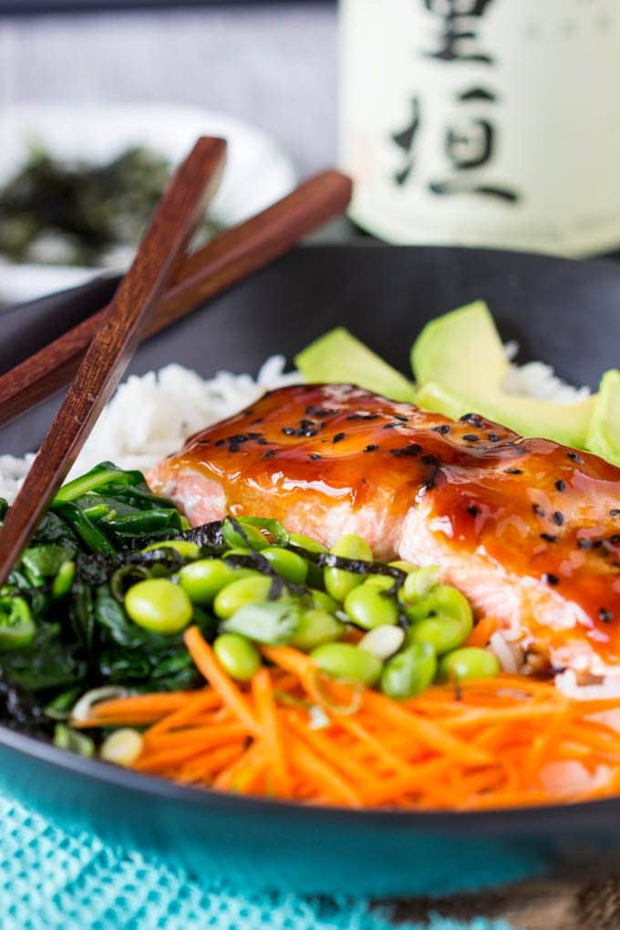 close up photo of salmon filet topped with homemade teriyaki and black sesame seeds