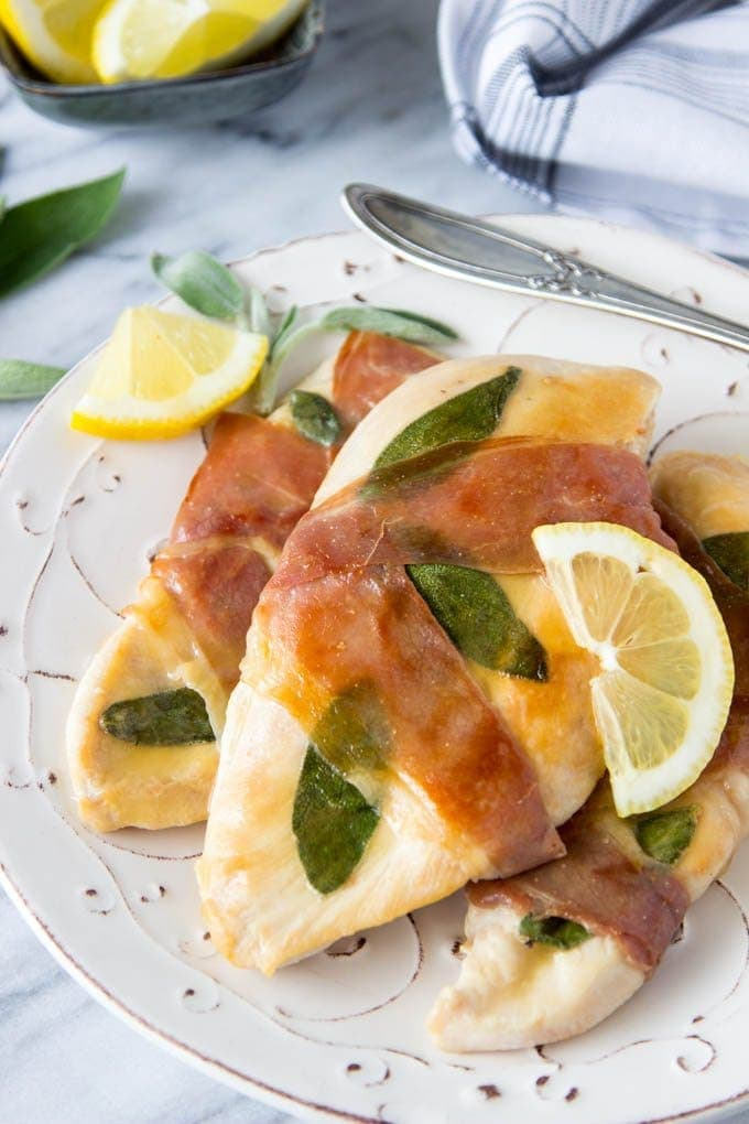 Lemon Chicken Saltimbocca-Super Easy! only 15 min from start to finish ( and it has a 5 star rating) Chicken and fresh sage wrapped with prosciutto and topped with a tangy lemon glaze #easy chicken recipe |simplehealthykitchen.com