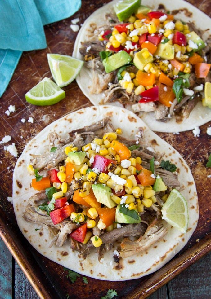 slow-cooker -pork-carnitas-tacos-corn-avocado- salsa lime