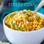 Mexican Street Corn in a white bowl with serving spoon