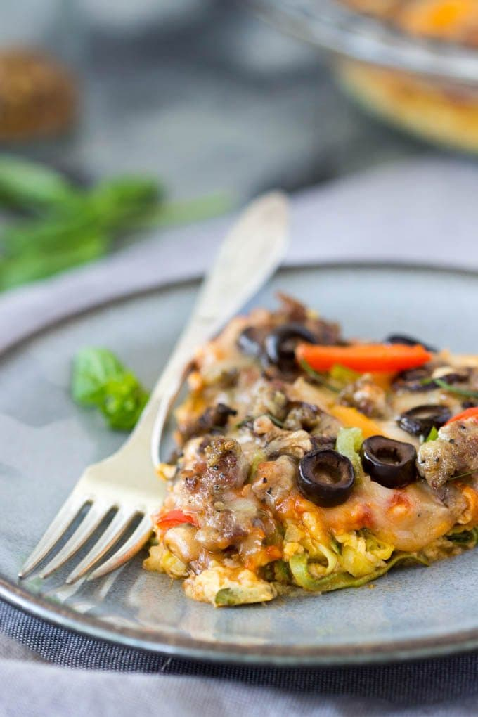 Piping hot pizza slices loaded with sausage, cheese, bell peppers, mushrooms and olives. All the things you love about pizza but with one big difference, this version is low-carb
