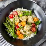 """Skillet Pesto Chicken- This one-pan skillet dinner can easily become your """"go-to"""" weeknight meal. Only 5 ingredients and about 20 minutes total time needed to whip up this healthy meal. Bonus! the 5 ingredients can be found year round but this recipe can easily be customized to take advantage of seasonal produce favorites."""