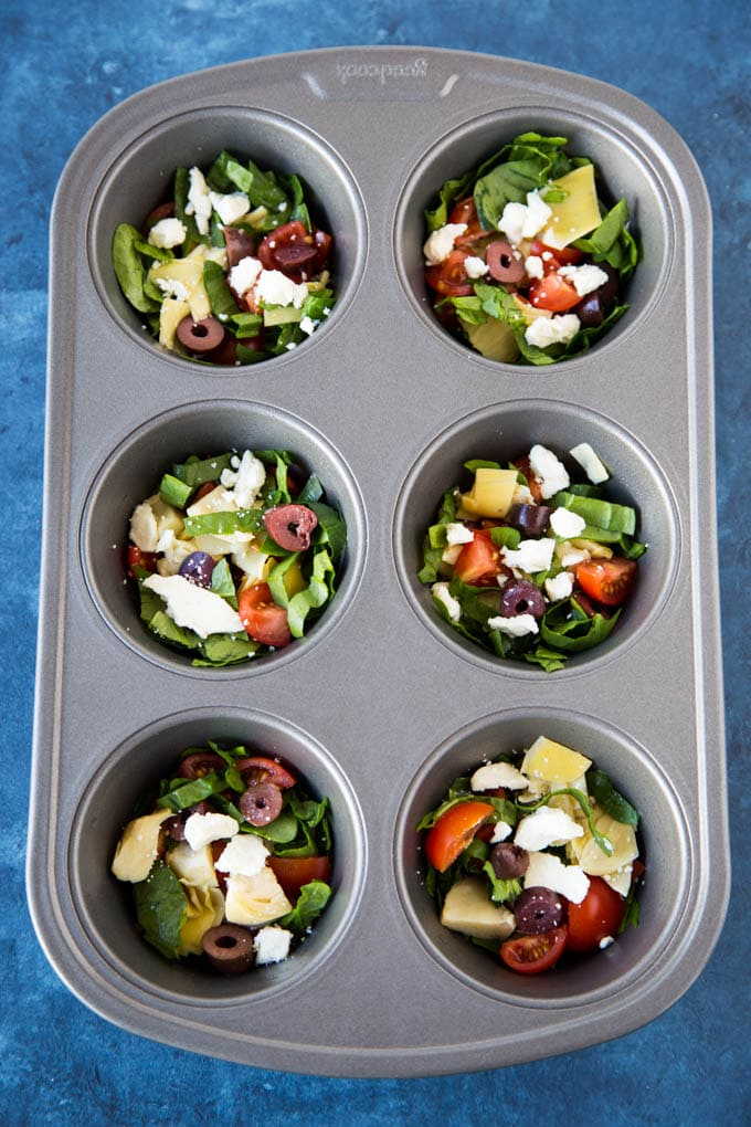 Mediterranean vegetables in muffin tin ready to bake omelette cups