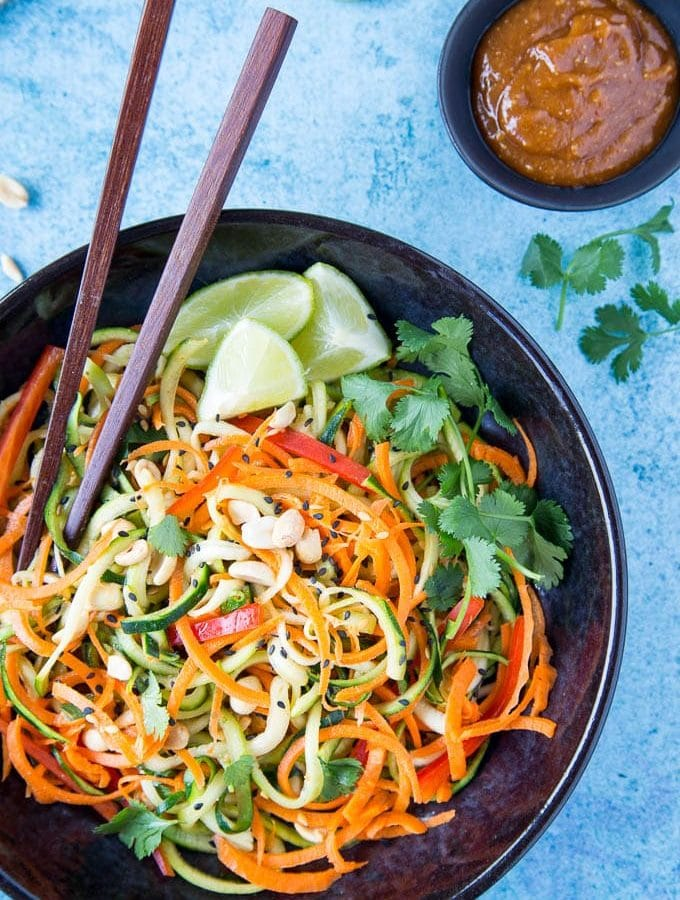 "Sesame Peanut Zucchini + Carrot Noodles - Spiralized zucchini and carrot ""noodles"" are tossed in a tasty sesame peanut sauce. A light and flavorful pasta alternative that makes a great side dish or add your favorite protein ( like chicken, shrimp or tofu) for a healthy full meal option. Ready in 10 mins.{ Clean eating, Vegan, easily Paleo}"
