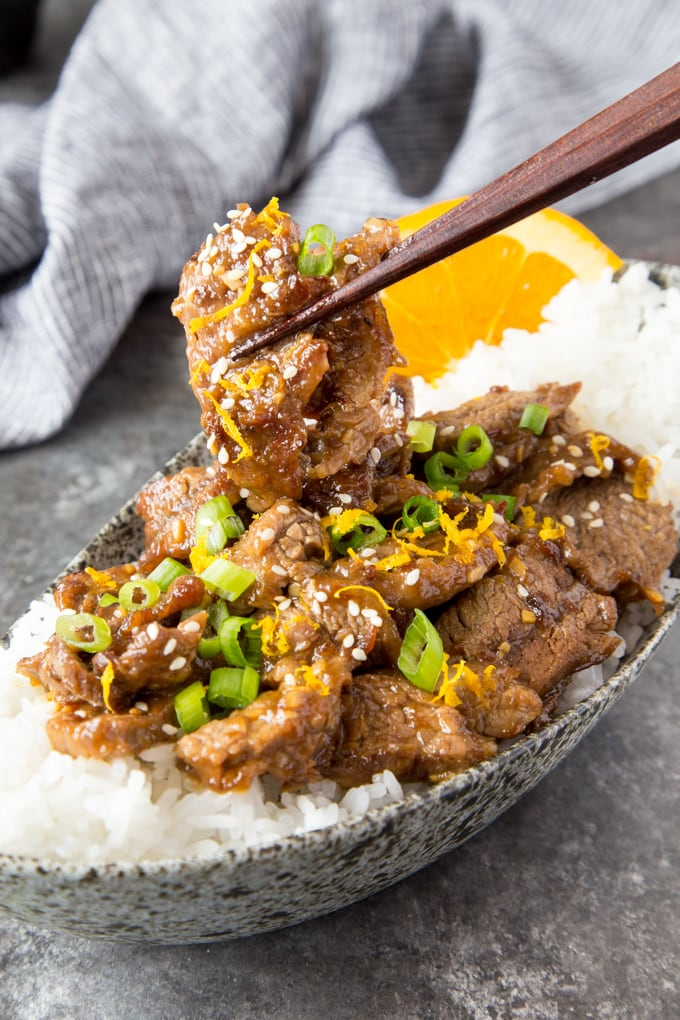 skillet sesame orange beef with chopsticks