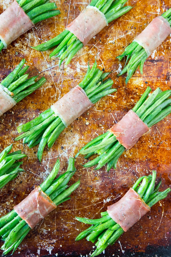 Green Bean + Prosciutto Bundles assemble and placed on a cookie sheet ready to be baked