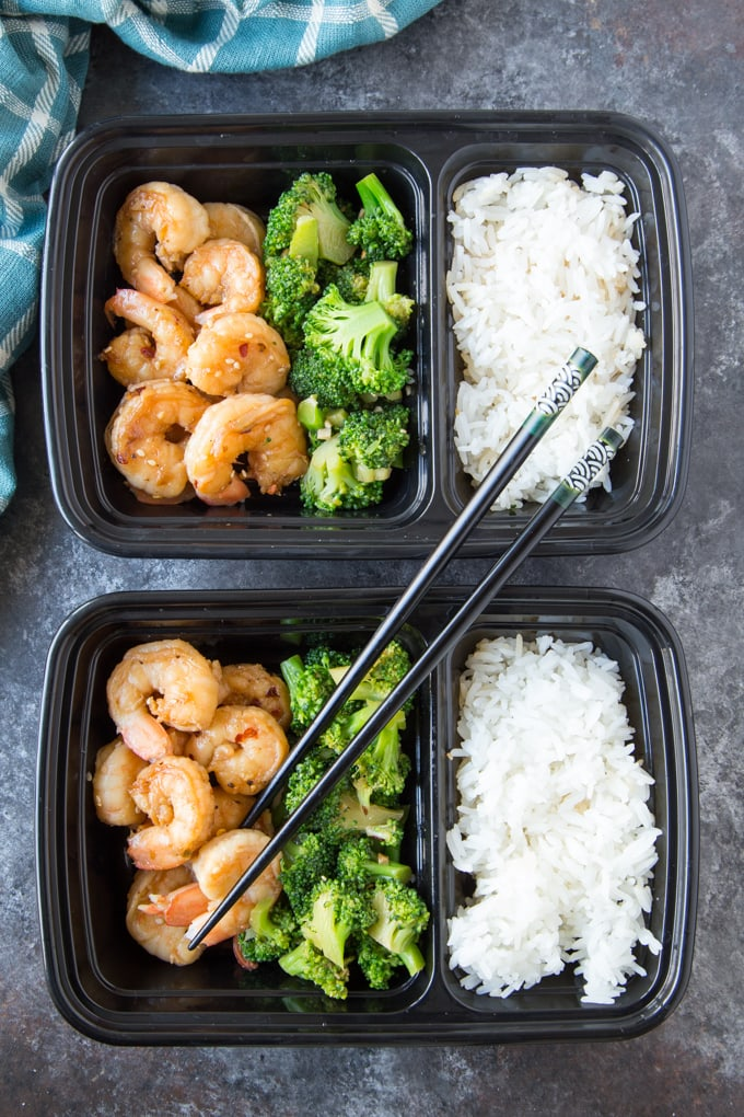 Honey Garlic Shrimp with broccoli and white rice in black meal prep containers