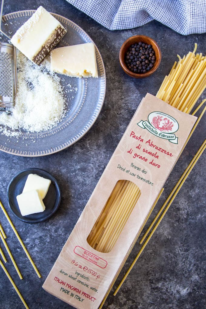 ingredients that are used to make Cacio e Pepe, bucatini pasta, butter, Pecorina cheese grated and black pepper corns